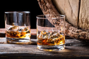 wooden barrel and whiskey glasses