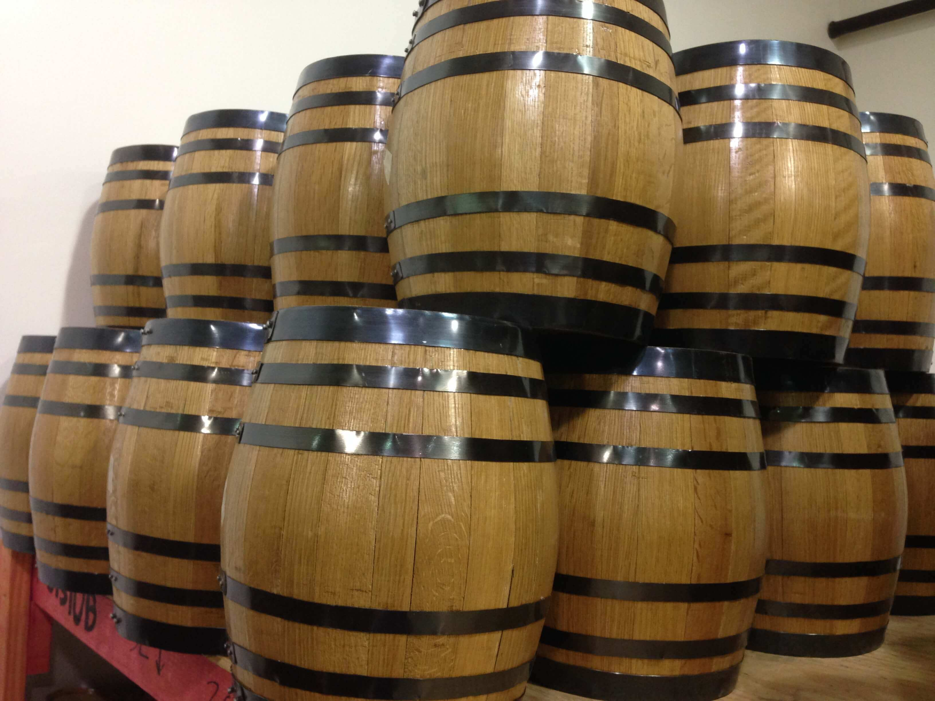Many Regional Distilleries Use Small Wooden Barrels For Aging Red