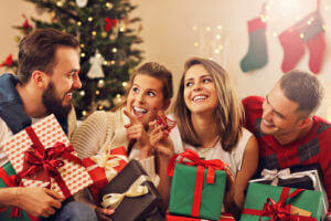 Happy Couples Opening Christmas Gifts